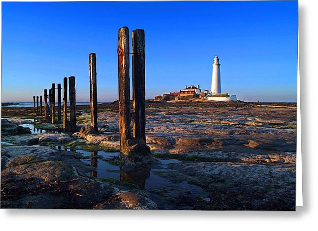 Sunset At St. Mary's Lighthouse Greeting Card by Michael Oakes