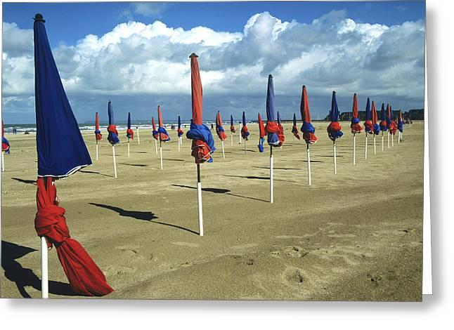 Sunshade On The Beach. Deauville. Normandy Greeting Card by Bernard Jaubert