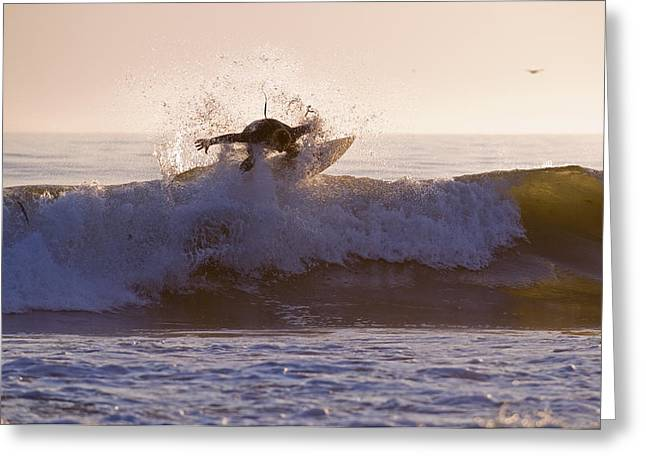 Surfer At Dusk Riding A Wave At Rincon Greeting Card by Rich Reid