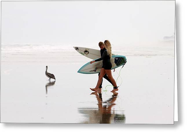 Greeting Card featuring the photograph Surfers And A Pelican by Alice Gipson