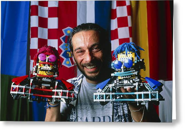 Technician With Lego Footballers At Robocup-98 Greeting Card by Volker Steger