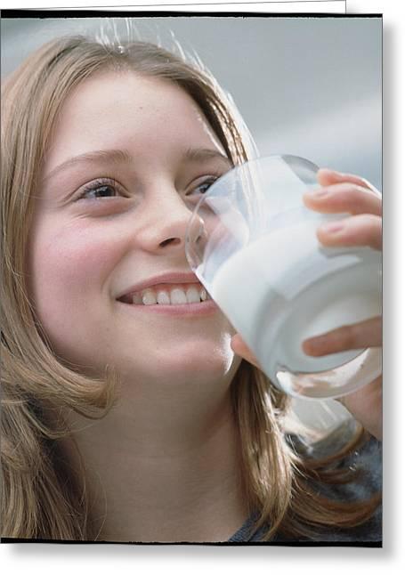 Teenage Girl Drinking A Glass Of Milk Greeting Card by Damien Lovegrove