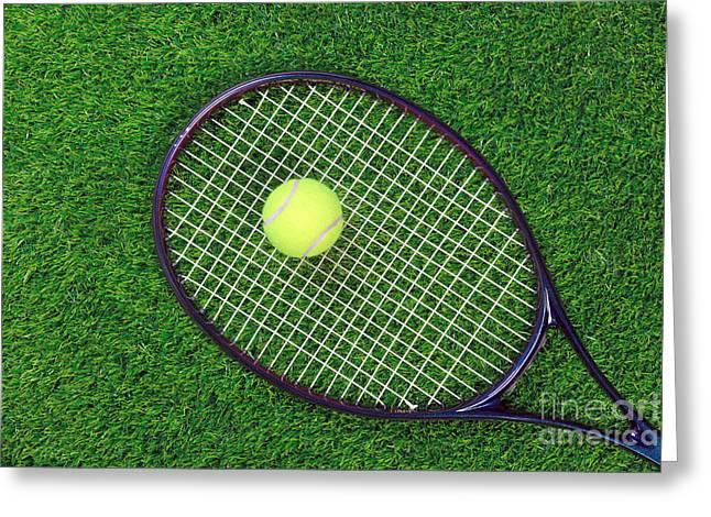 Tennis Raquet And Ball On Grass Greeting Card