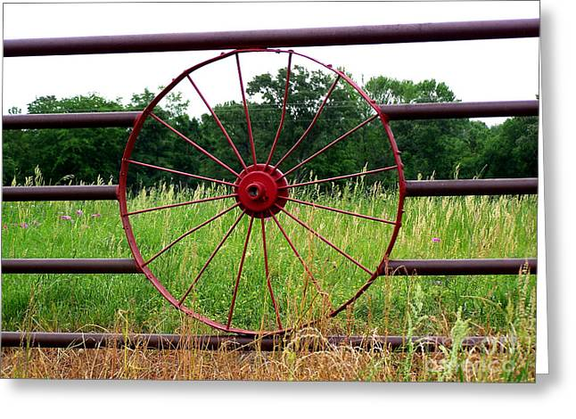 Greeting Card featuring the photograph Texas Wildflowers Through Wagon Wheel by Kathy  White