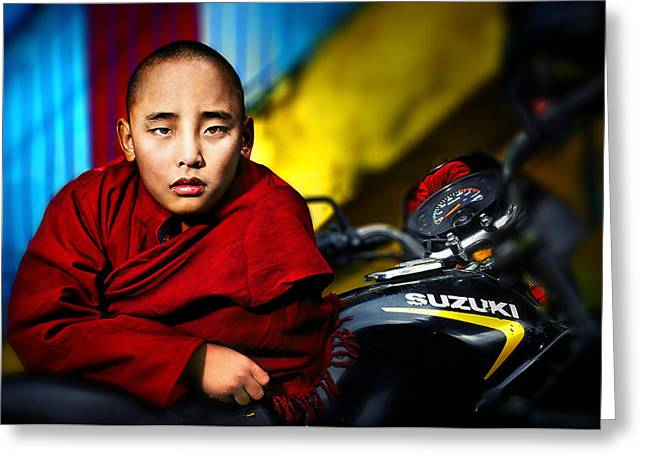 The Boy Monk In Red Robe Standing Beside A Motorcycle In A Buddh Greeting Card by Max Drukpa