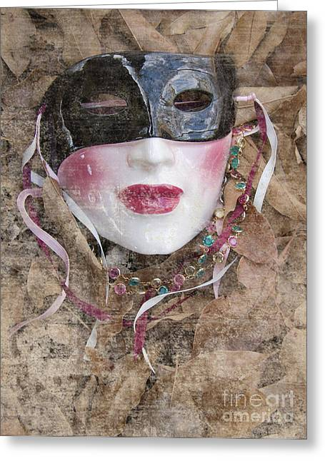 The Mask In The Leaves Greeting Card by Carolyn Fox