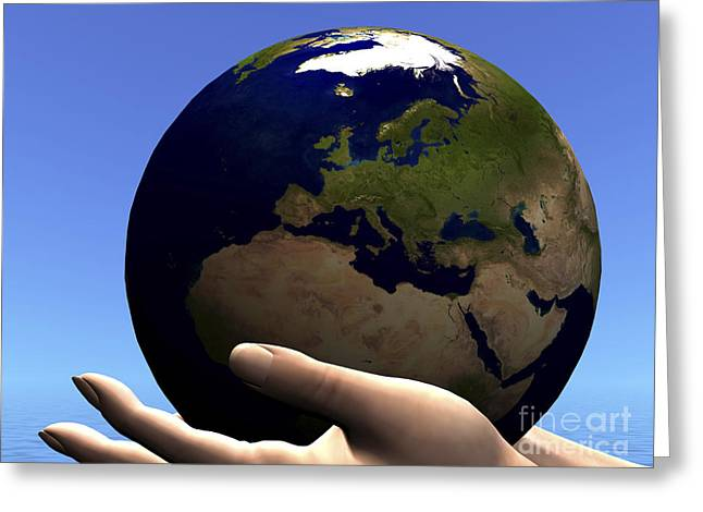The Planet Earth Is Held In Caring Greeting Card by Corey Ford