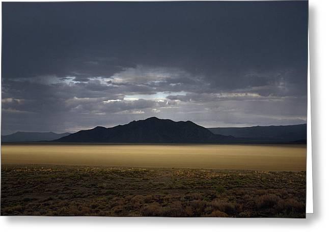 The Setting Sun Permeates Rain Clouds Greeting Card by James P. Blair