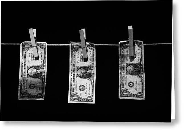 Three One Dollar Bill Banknotes Hanging On A Washing Line With Blue Sky Greeting Card by Joe Fox