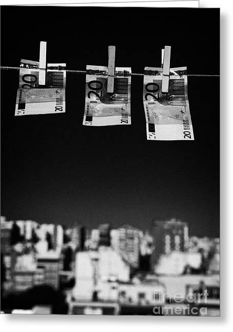 Three Twenty Euro Banknotes Hanging On A Washing Line With Blue Sky Over City Skyline Greeting Card by Joe Fox