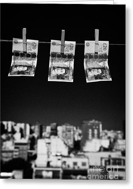 Three Twenty Pounds Sterling Banknotes Hanging On A Washing Line With Blue Sky Above A City Skyline Greeting Card by Joe Fox