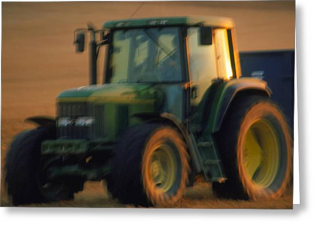 Time-exposure Image Of A Tractor At Work Greeting Card by Jeremy Walker