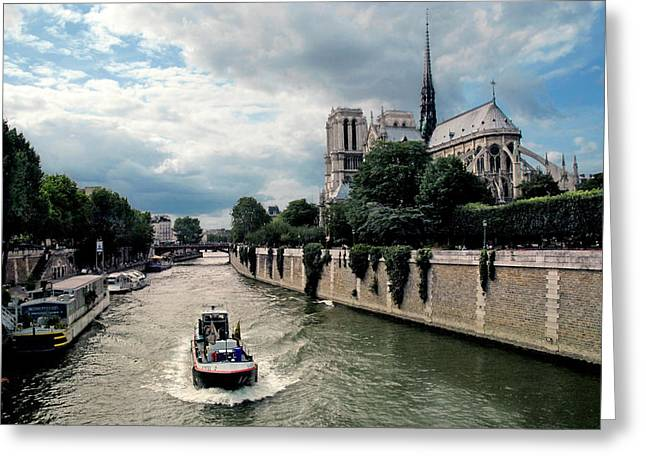 Greeting Card featuring the photograph Tour Boat Passing Notre Dame by Dave Mills