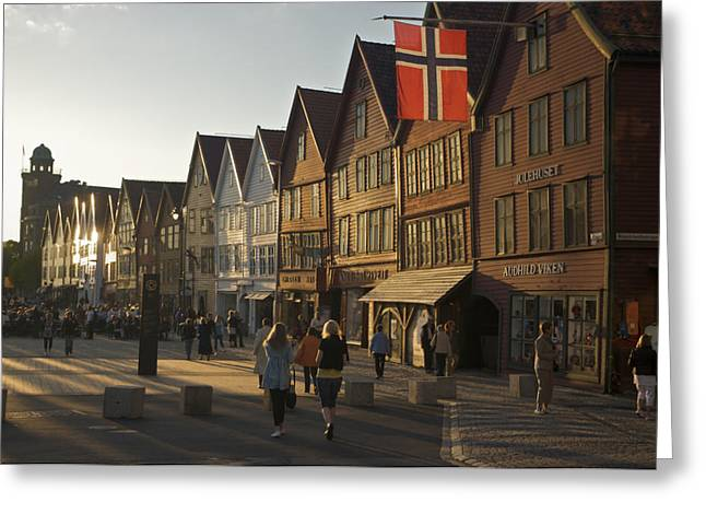 Tourists Walking In A Street In Bergen Greeting Card by Michael Melford