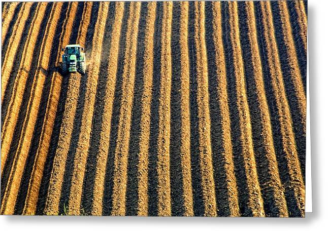 Tractor Plowing A Field Greeting Card by John Short