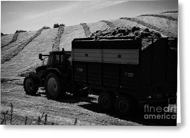 Tractos Towing Trailer Full Of Grass For Silage Production Irish Field Ireland Greeting Card by Joe Fox