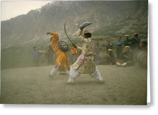 Two Dancers Perform A Local Dance Using Greeting Card