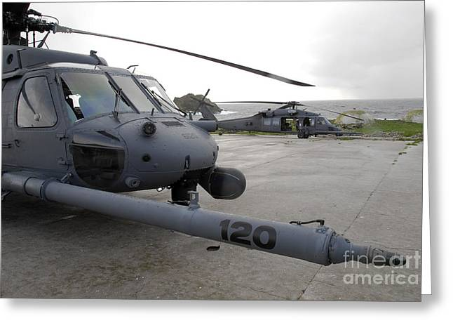 Two Hh-60g Pave Hawks Sit At A Helipad Greeting Card by Stocktrek Images