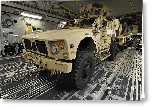 Two M-atvs Await Transport On A C-17 Greeting Card by Stocktrek Images