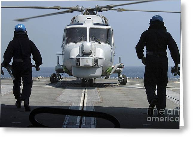 Two Royal Navy Sailors Prepare Greeting Card by Stocktrek Images