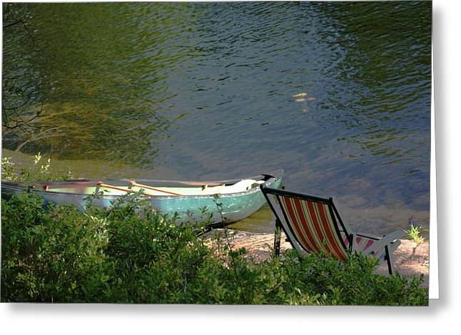 Typical Canoe And Chair Greeting Card by Carolyn Reinhart