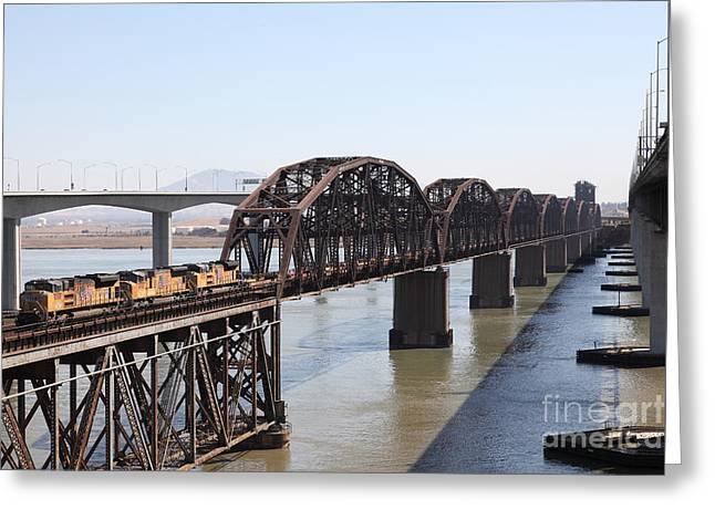 Union Pacific Locomotive Trains Riding Atop The Old Benicia-martinez Train Bridge . 5d18849 Greeting Card