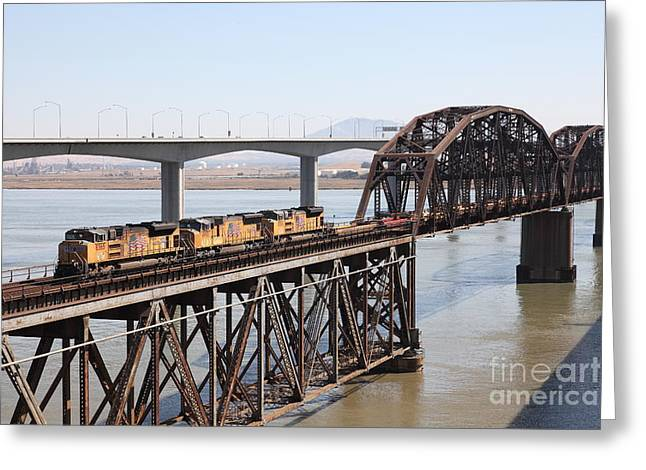 Union Pacific Locomotive Trains Riding Atop The Old Benicia-martinez Train Bridge . 5d18850 Greeting Card