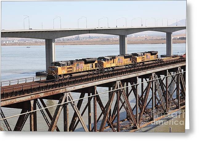Union Pacific Locomotive Trains Riding Atop The Old Benicia-martinez Train Bridge . 5d18851 Greeting Card