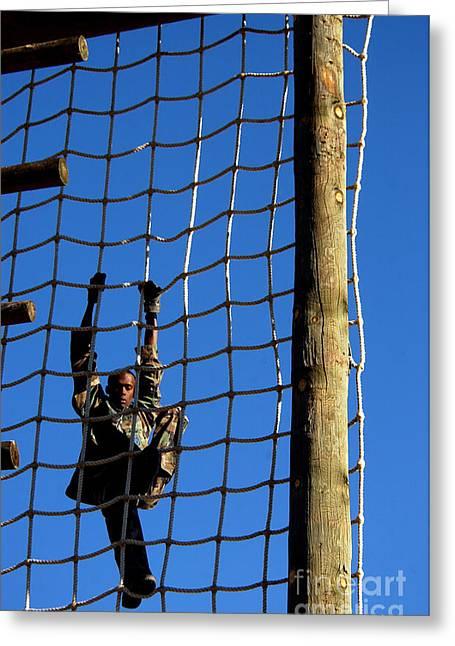 U.s. Air Force Airman Climbing Net Greeting Card by Stocktrek Images