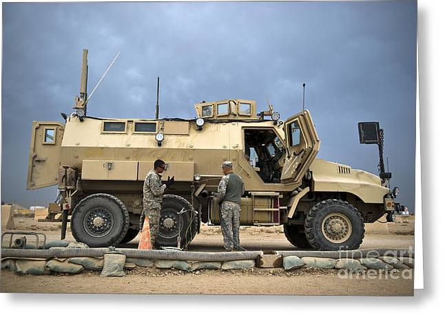 U.s. Army Sergeant Refuels A Caiman Greeting Card by Stocktrek Images