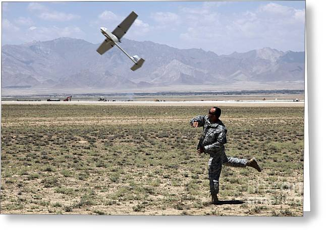 U.s. Army Soldier Launches An Rq-11 Greeting Card by Stocktrek Images