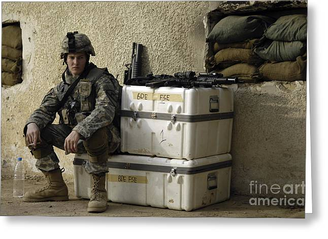 U.s. Army Soldier Relaxing Before Going Greeting Card by Stocktrek Images