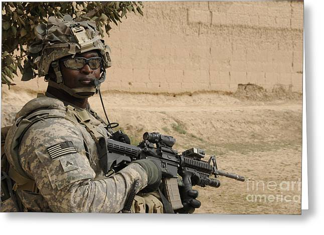 U.s. Army Soldier Scans His Area While Greeting Card by Stocktrek Images