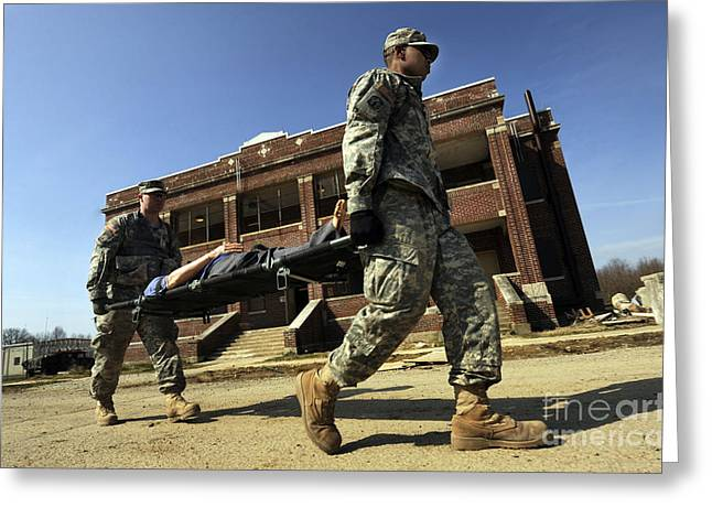 U.s Army Soldiers Transport A Manikin Greeting Card by Stocktrek Images