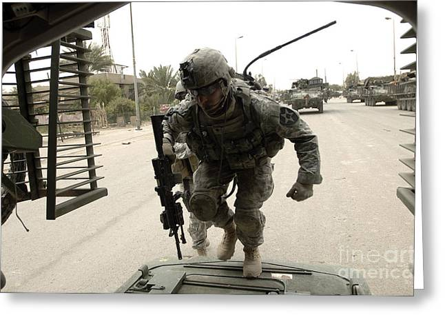 U.s. Army Specialist Entering A Stryker Greeting Card by Stocktrek Images