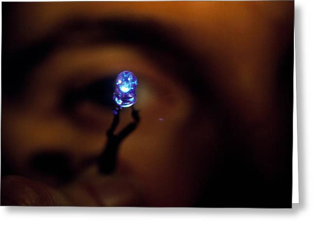 View Of A Man Holding A Blue Light Emitting Diode Greeting Card by Volker Steger