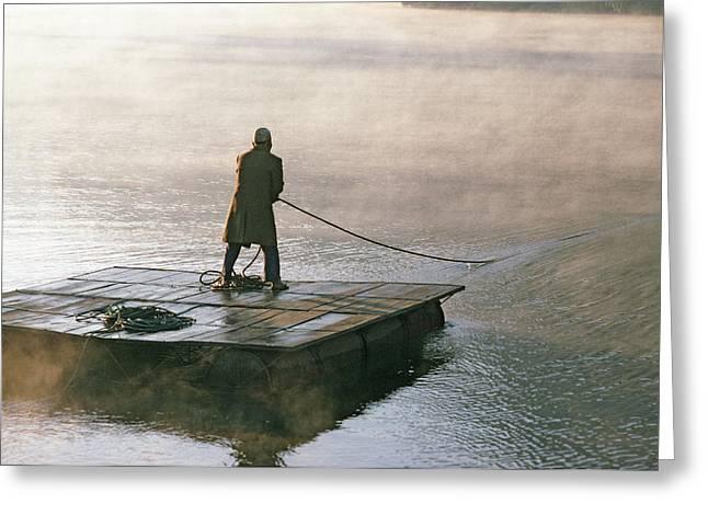 Villager On Raft Crosses Lake Phewa Tal Greeting Card by Gordon Wiltsie