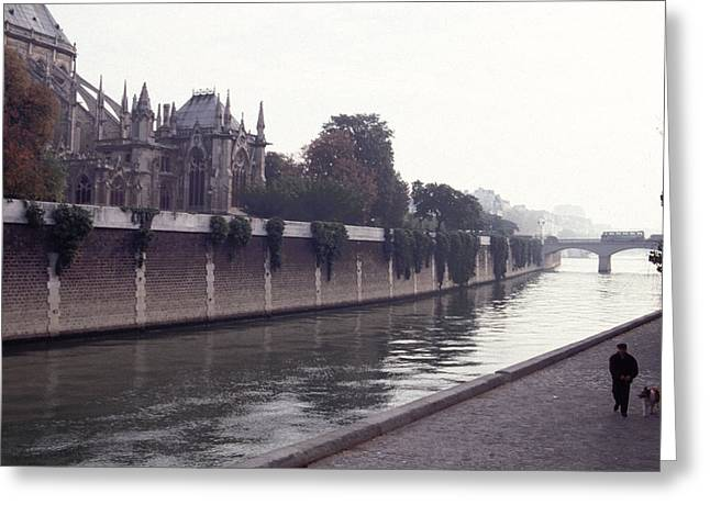 Greeting Card featuring the photograph Walking The Dog Along The Seine by Tom Wurl