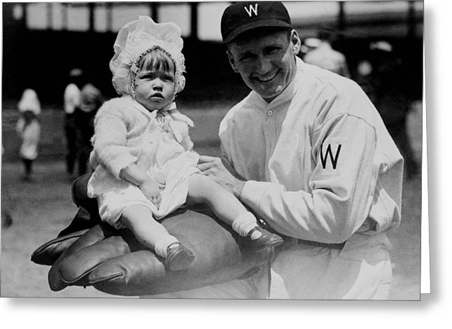 Greeting Card featuring the photograph Walter Johnson Holding A Baby - C 1924 by International  Images