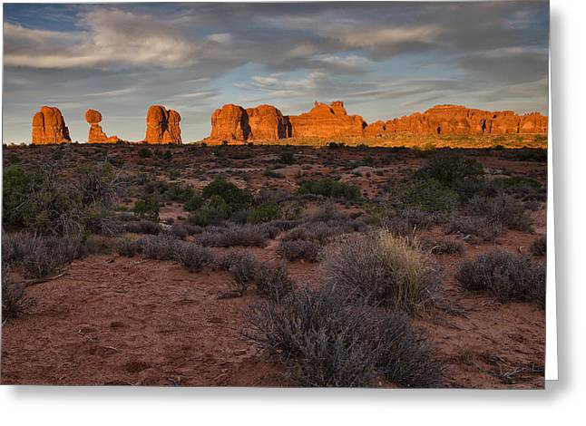 Warm Glow Over Arches Greeting Card by Andrew Soundarajan