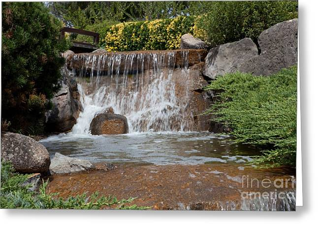 Waterfall In A Japanese Garden Greeting Card by John Buxton