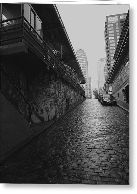 Greeting Card featuring the photograph Wet Cobbles by Mitch Shindelbower
