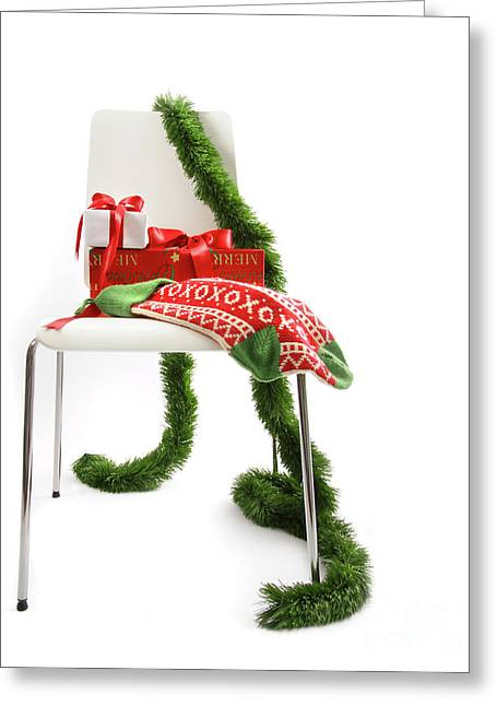White Chair With Gifts And Garland On White  Greeting Card by Sandra Cunningham
