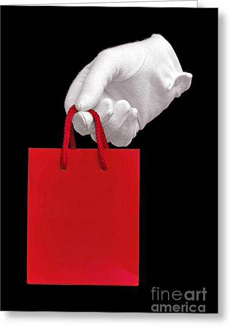 White Glove Holding A Red Gift Bag Greeting Card by Richard Thomas