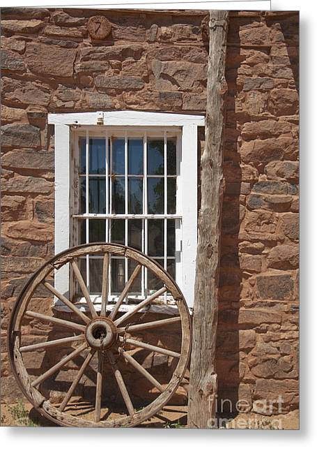 Window In Stone Building With Wagon Wheel Greeting Card by Thom Gourley/Flatbread Images, LLC