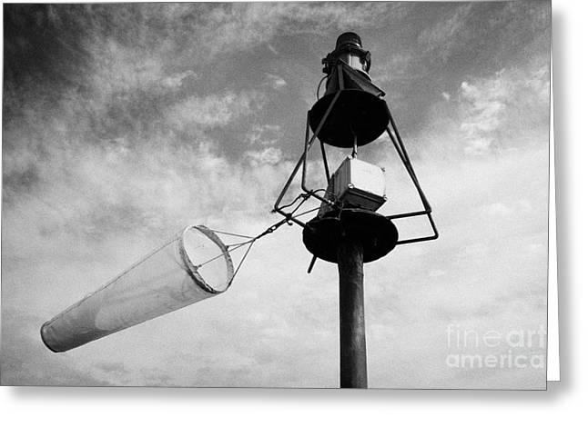 windsock flying on a harbour light mast in high winds John OGroats scotland uk Greeting Card by Joe Fox