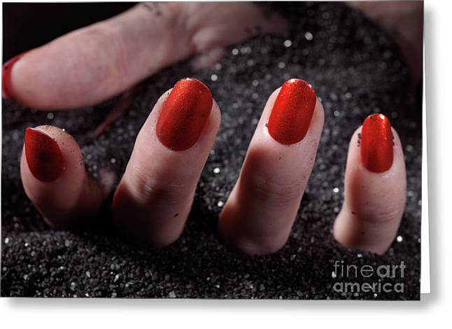 Woman Hand With Red Nail Polish Buried In Black Sand Greeting Card by Oleksiy Maksymenko