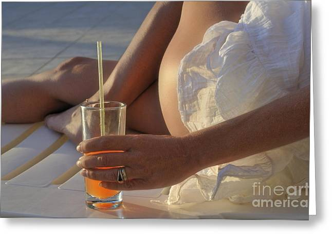 Woman Holding Cocktail Glass While Sunbathing Greeting Card by Sami Sarkis