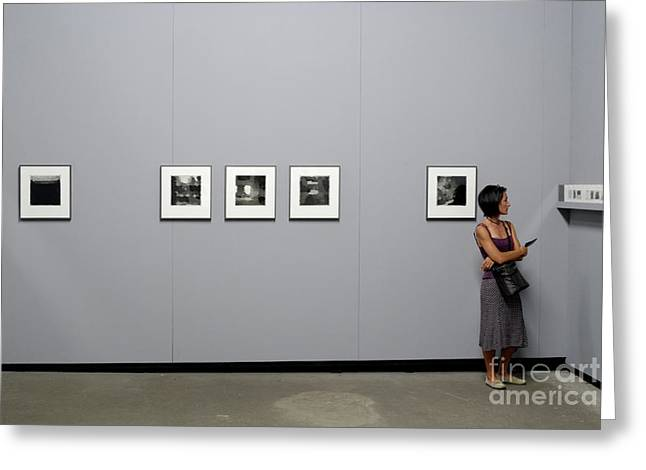 Woman Watching Photos At Exhibition Greeting Card by Sami Sarkis