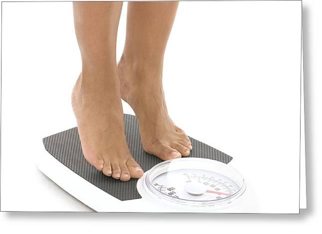 Woman Weighing Herself Greeting Card